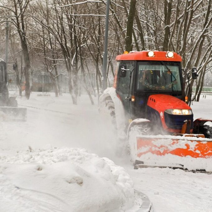 a bulldozer truck removing the snow